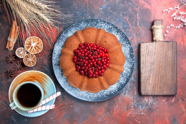 Cake with berries cake with berries sweets a cup of tea lemon cutting board