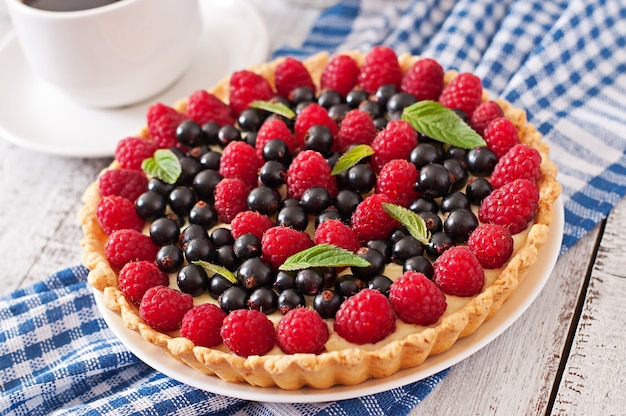 Cake with berries and custard
