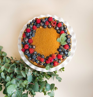 Cake with berries and green leaves