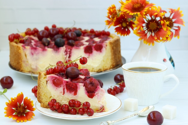 Cake with berries is located on a plate