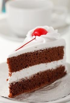 バックグラウンドでコーヒーカップとケーキ