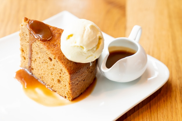 Cake with vanilla ice-cream and toffee caramel sauce