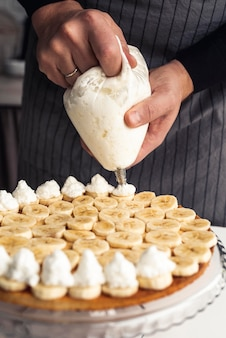 Cake with whipping cream and banana