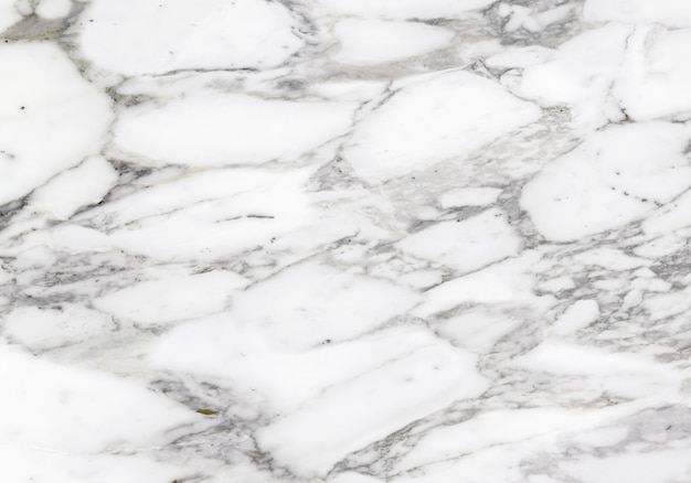 Мраморная текстура calacatta сделана из смеси чисто белых и серых оттенков. белый каменный фон.