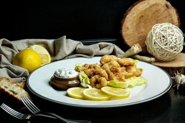 Calamari rings served with lemon and mayonnaise