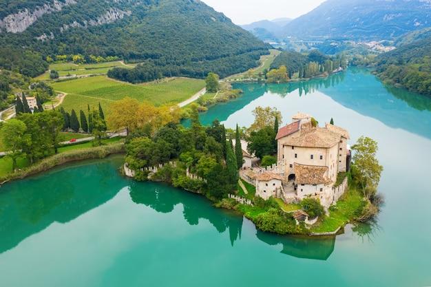 Calavino, italy - october 09, 2019: toblino castle on a beautiful lake.