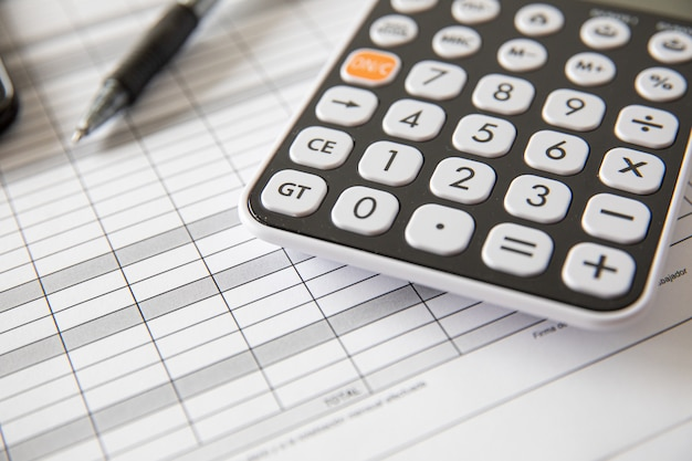 Calculating taxes and profit at office. concept bussines
