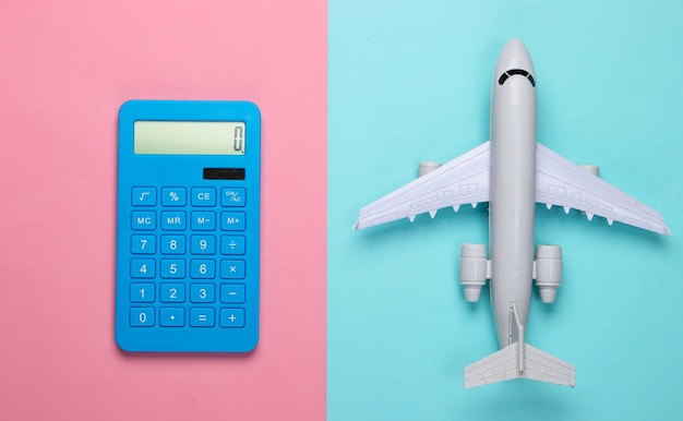 Calculation of the cost of travel, air travel or air delivery. calculator with  airplane figure on pink blue pastel background. top view