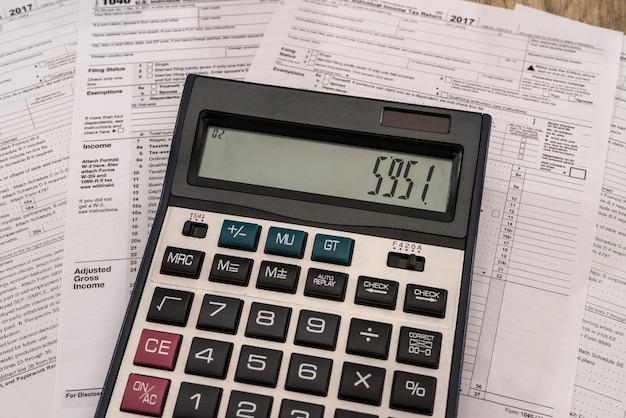 Calculator on 1040 tax form close up