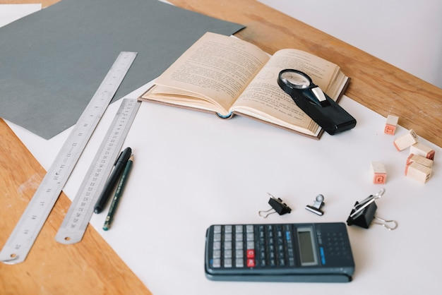 Calculator and book near stationery