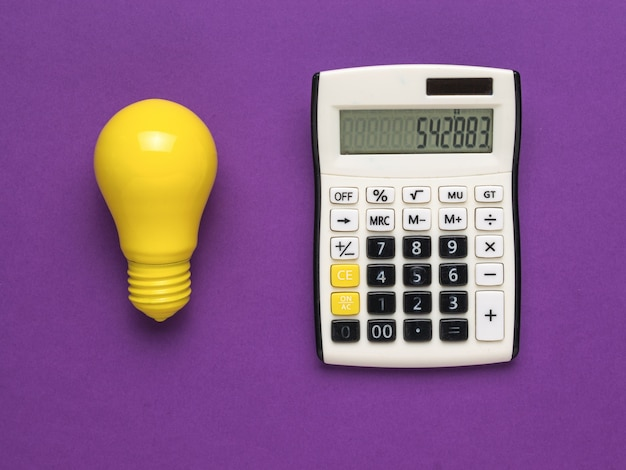 A calculator and a bright yellow light bulb on a purple background.