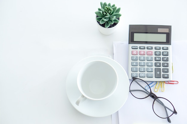 Calculator, a empty cup, glasses is ready for the business person to use