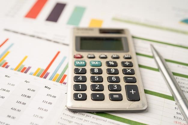 Calculator on graph paper finance development banking account statistics investment