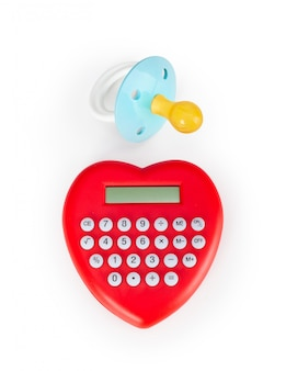 Calculator heart shaped and pacifier.