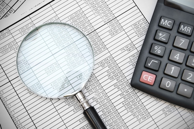 Calculator and magnifier on documents.