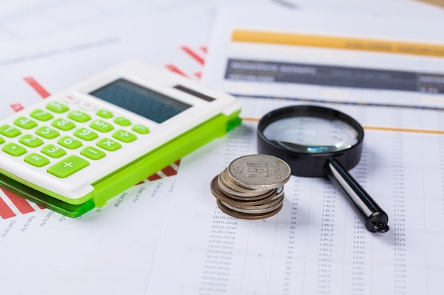 Calculator and magnifying glass on the table