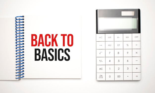 Calculator and notepad with text back to basics