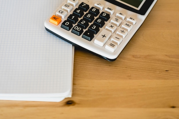 Calculator and pad to calculate business expenses