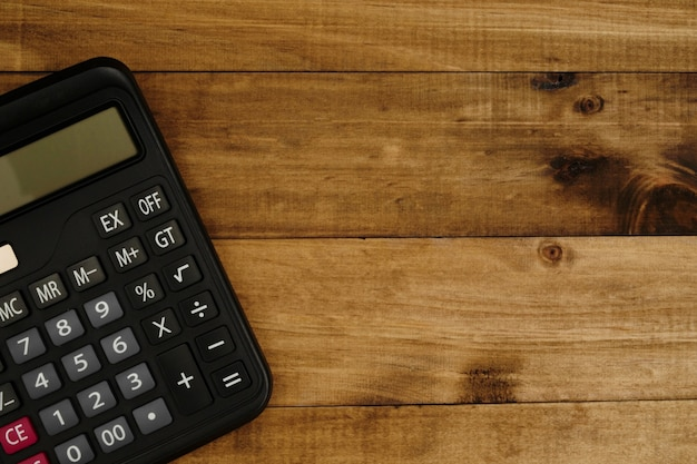 Calculator placed on a wooden floor