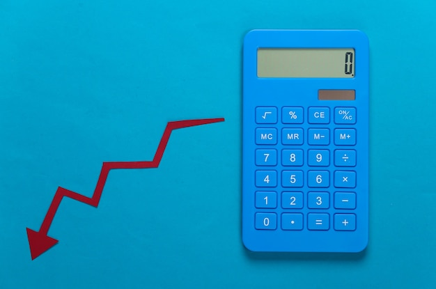 Calculator and red fall arrow. fall graph going down. economic recession, crisis