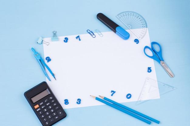 Калькулятор, линейка, маркер, скрепки, компасы, ножницы и белый лист бумаги