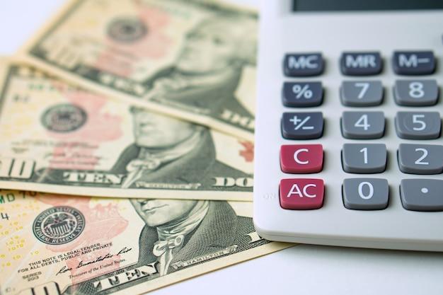 Calculator on ten dollars banknotes