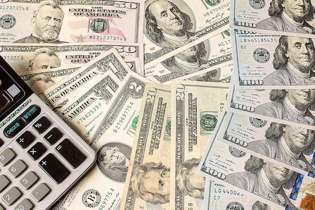 Calculator on us dollars banknotes