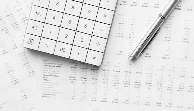 Calculator with pen on financial data. business and financial research concept.