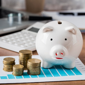Calculator with piggy bank and growth chart