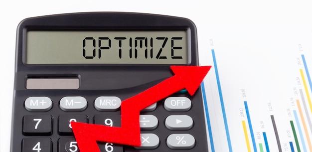 ディスプレイに赤い上向き矢印とテキストoptimizeが表示された電卓
