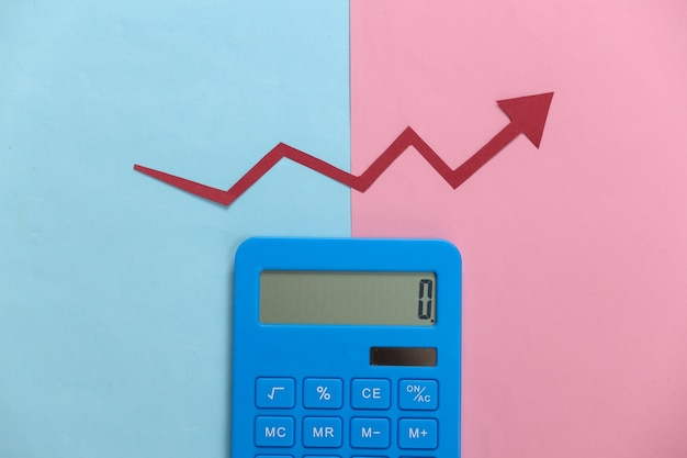 Calculator with red growth arrow on pink blue. arrow graph going up. the economic growth