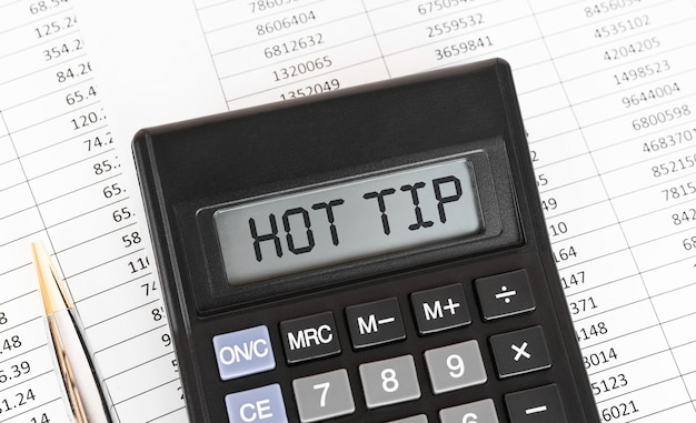 Calculator with the word hot tip on the display.