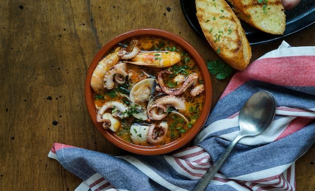 Caldereta (spanish seafood stew), traditional northern spanish seafood meal