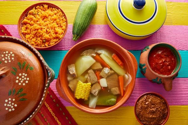 Caldo de res mexican beef broth in table