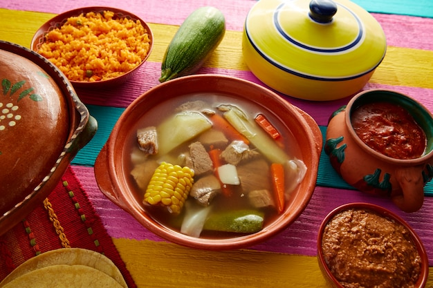 Caldo de res mexican beef broth in table
