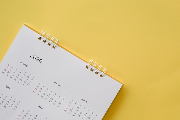 Calendar 2020 month on yellow background for planning work and life concept