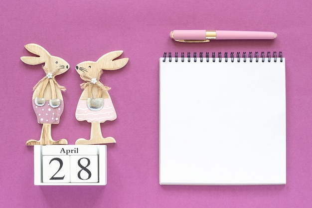 Calendar april 28,  easter bunnies, white notepad concept christian easter
