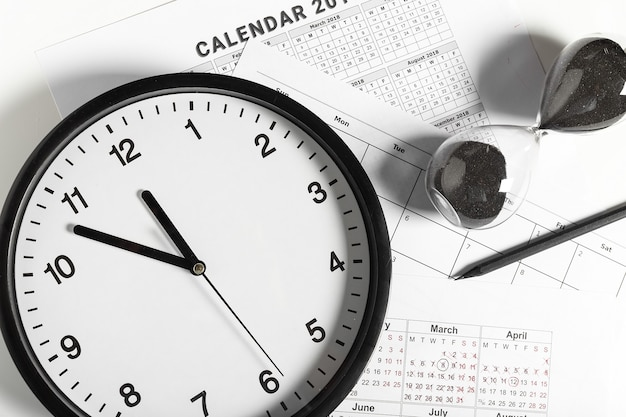 Calendar and clock on white background