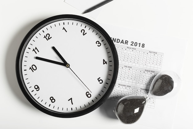 Calendar and clock on white