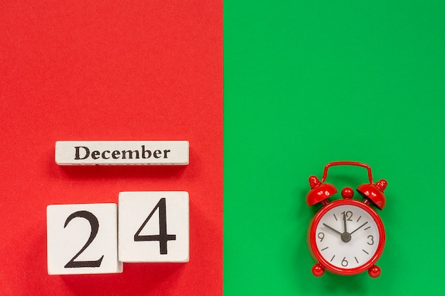 Calendar december 24th and red alarm clock