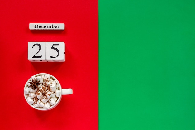 Calendar december 25th and cup of cocoa with marshmallows
