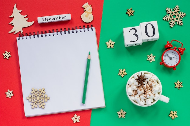Calendar december 30th cup cocoa and marshmallow, empty open notepad