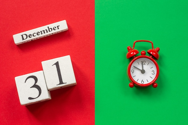 Calendar december 31st and red alarm clock