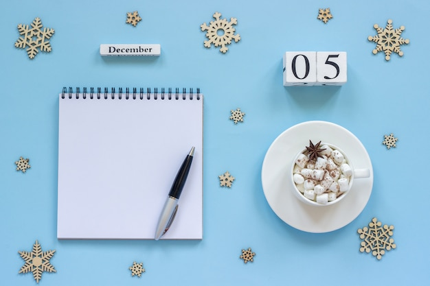 Calendar december 5 cup cocoa and marshmallow, empty open notepad