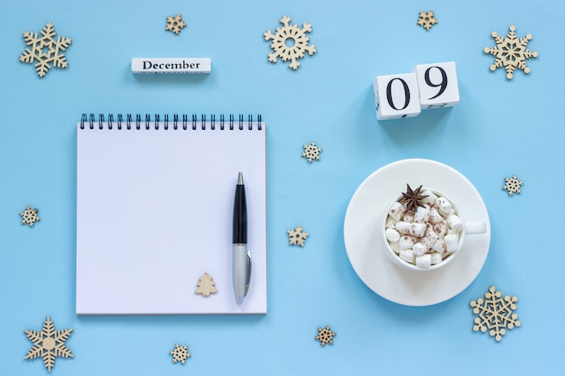 Calendar december 9 cup cocoa and marshmallow, empty open notepad