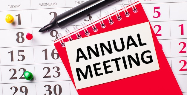 On the calendar is a white card with the text annual meeting