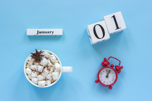 Calendar january 1, cup of cocoa with marshmallows and alarm clock