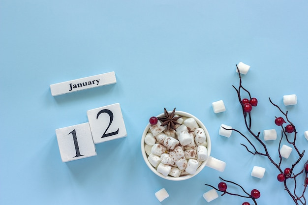 Calendar january 12 cup of cocoa, marshmallows and branch berries