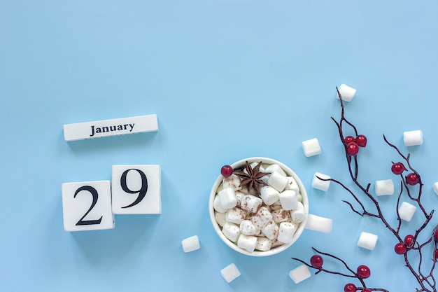 Calendar january 29 cup of cocoa, marshmallows and branch berries