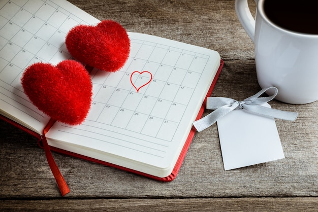 Calendar memo, notebook with the red heart pillow, coffee cup